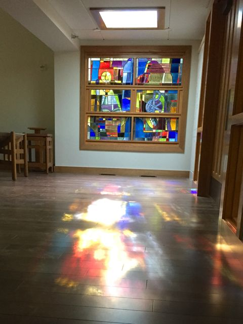 After spending almost 7 months in storage, the remaining panels of stained glass that were removed from the old sanctuary are now settled in their new home.