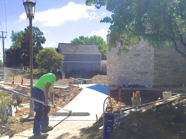 After several rainy days, Mother Nature finally let us have another visit from the cement crew. They poured a new ramp for the 54th Street entrance, and also connected the front sidewalk to the steps leading down to the east parking lot.