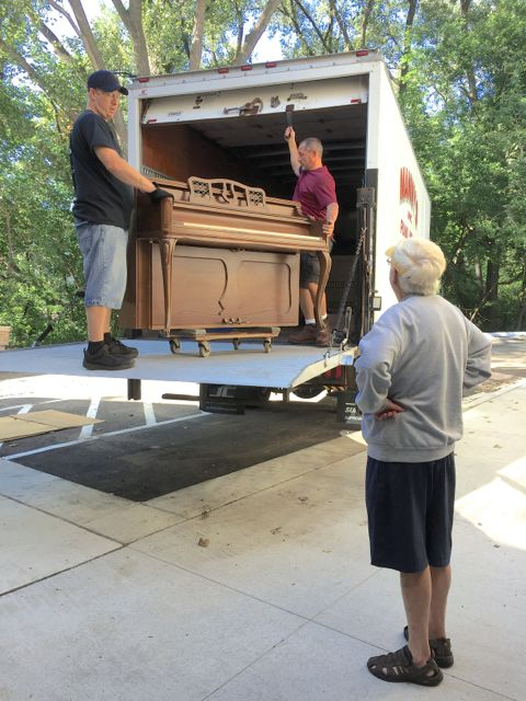 John Strom supervises the delivery of the piano that he and Nancy Strom donated to ECLC.