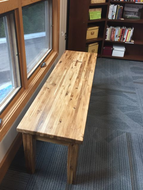 Last fall when trees within the construction zone had to be cut down, ECLC members harvested logs to turn into lumber. Jim Strom decided to use some to create furniture for our revamped church. Today, he brought in the first piece: a beautiful, oak bench for the library.