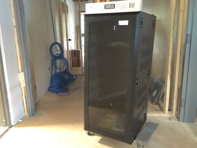 Soon, our rat's nest of IT cables and equipment will be neatly housed in our new network cabinet.