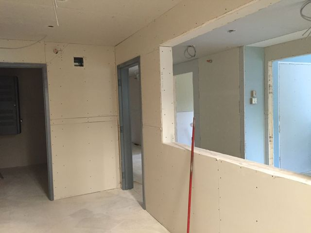 Drywall installation is now complete throughout the new office suite.