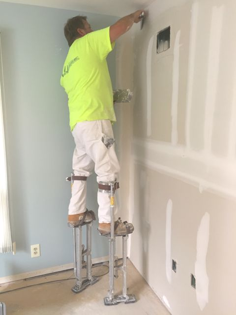 Taping and mudding of the office suite drywall is well underway.