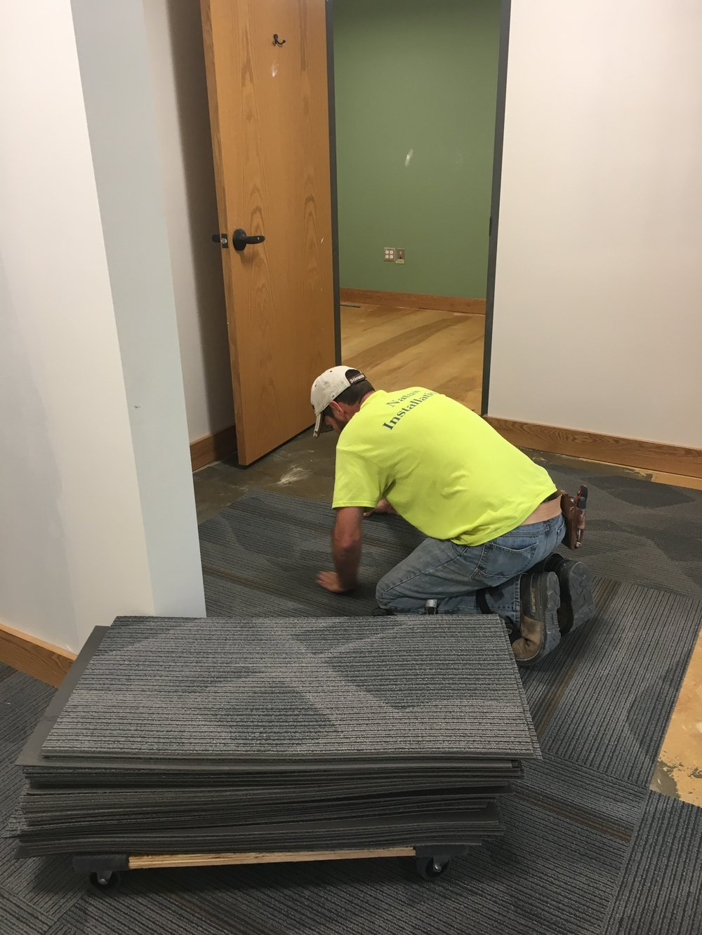 Paint, baseboards, and carpet are the latest signs of progress in the office suite.