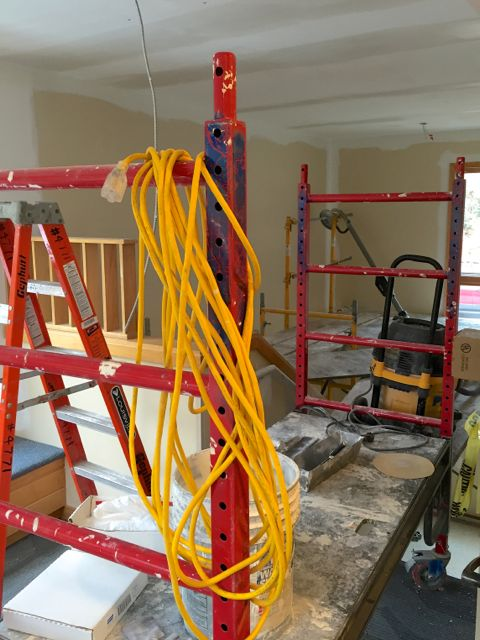 A complex tower of scaffolding was constructed in the northwest stairwell so that workers could update the ceiling, install new light fixtures, and paint.