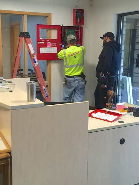 Today, the electrician and security system technician teamed up to upgrade our alarm monitoring equipment.