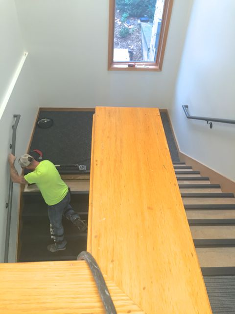 Today, workers installed carpeting in the northwest stairwell and on the window nook bench, a favorite conversation spot for small groups.