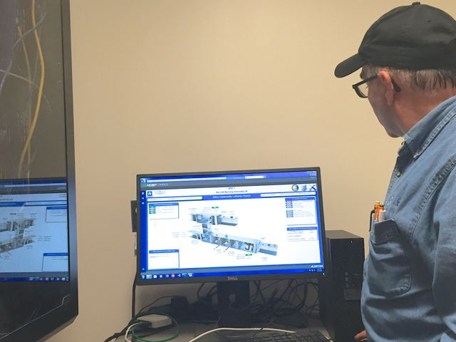 The new computerized HVAC (heating, ventilation and air conditioning) control system will greatly increase our building's energy efficiency, as well as the comfort of the folks inside. Above, a technician reviews the programming for the sanctuary air handler.