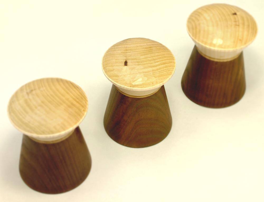 Set of three large half ebonised pegs