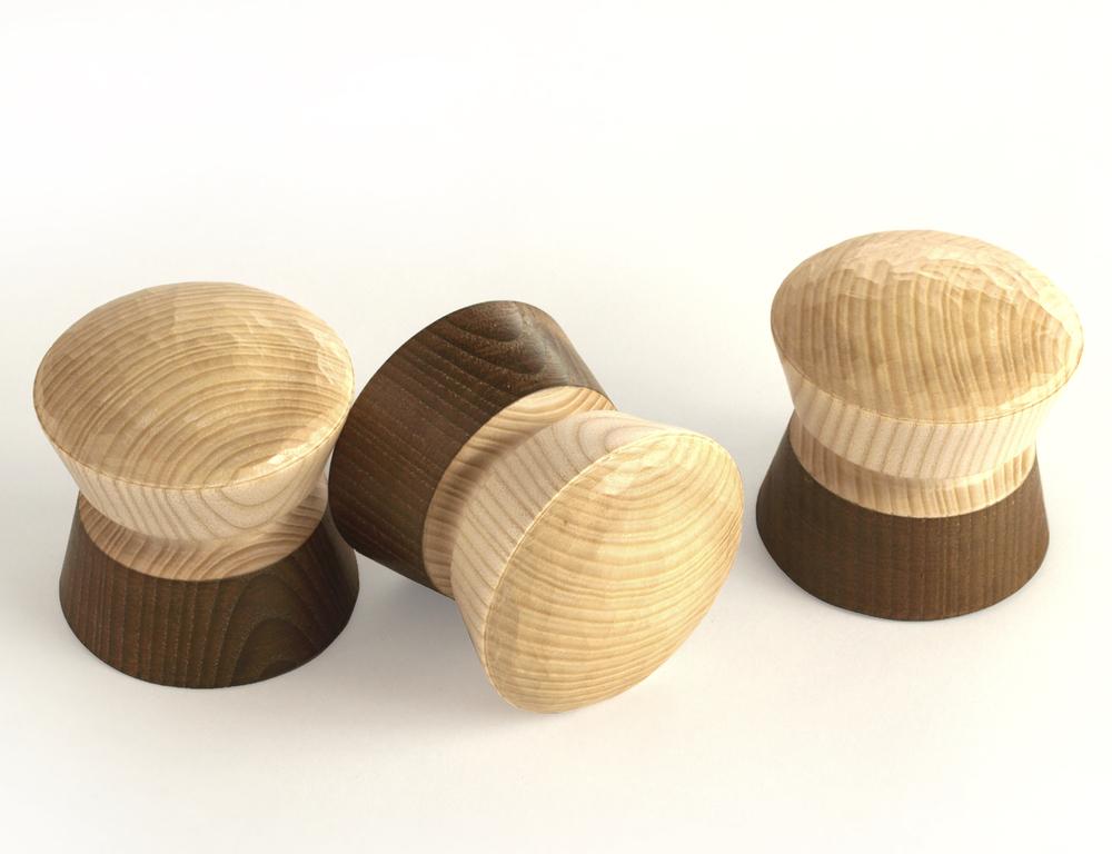 Set of three short large half ebonised pegs