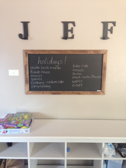 This is our organised wall. A blackboard for reminders e.g. swimming lessons, library books, hooks for hats and a place for bags and shoes. This has changed my life and cleared my kitchen bench, highly recommend making yourself one. You will see this wall again soon during a normal routine week. It is much fuller!