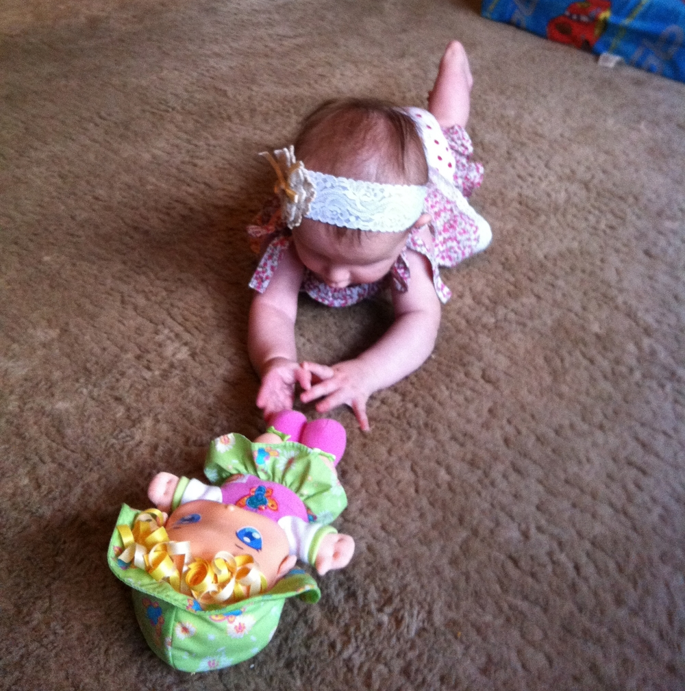 Eva crawled for the first time reaching for her doll