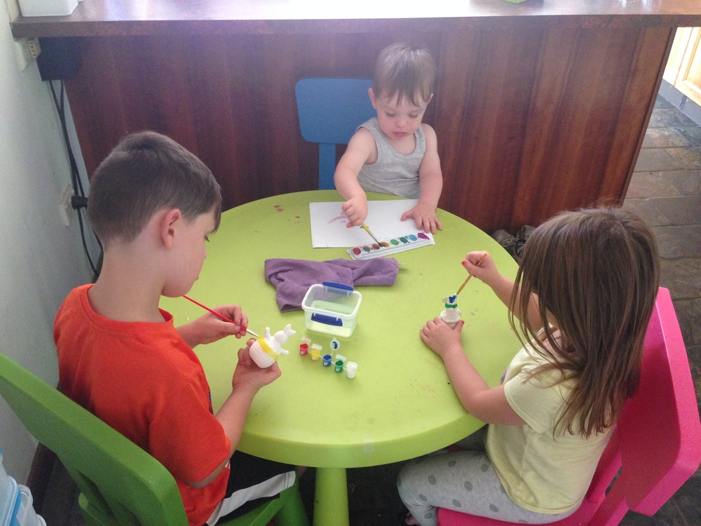 Painting with little brushes is great for fine motor development