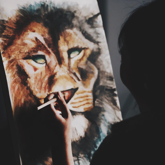 Ming, a prophetic artist painting the Lion of Judah.
