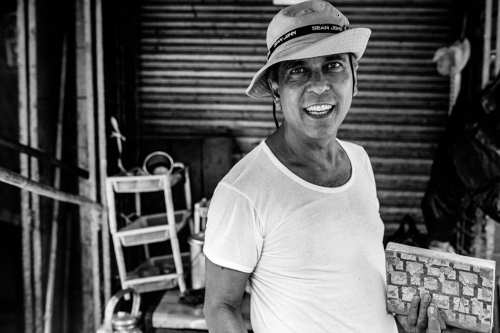 When I first saw him, he was fiercely writing notes in his journal about his sales in the market but once I said  Mingalapar,  he stopped writing, pulled me into his stall and took my hat then ask me to take his portrait. We spent another ten minutes talking about where we came from despite of how busy he was at that point in time.
