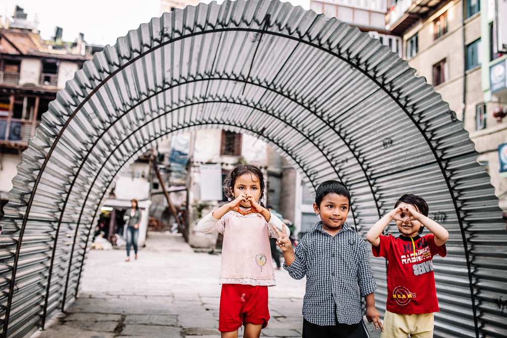 Children playing infront of a makeshift tent for those who have lost their homes.  Bakhtapur, Nepal | 2015