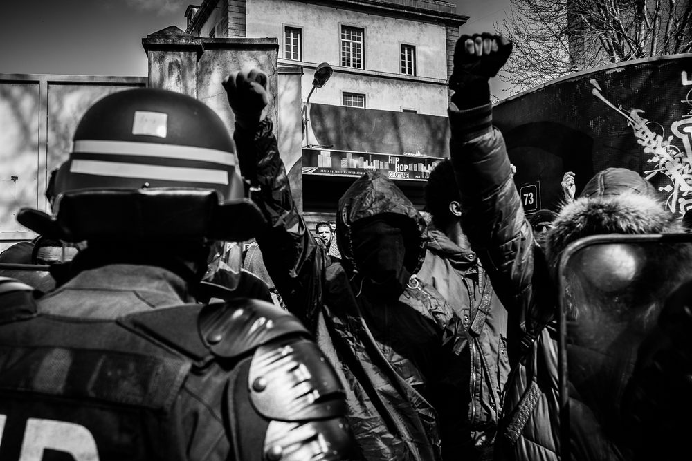 Two protestors raising their fists into the air in defiance of the brutal tactics adopted by the riot police. 5th April 2016.