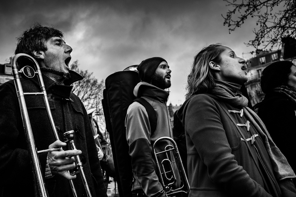 A band of musicians performing nationalistic songs for the crowd at Nuit Debout, 3rd April 2016.