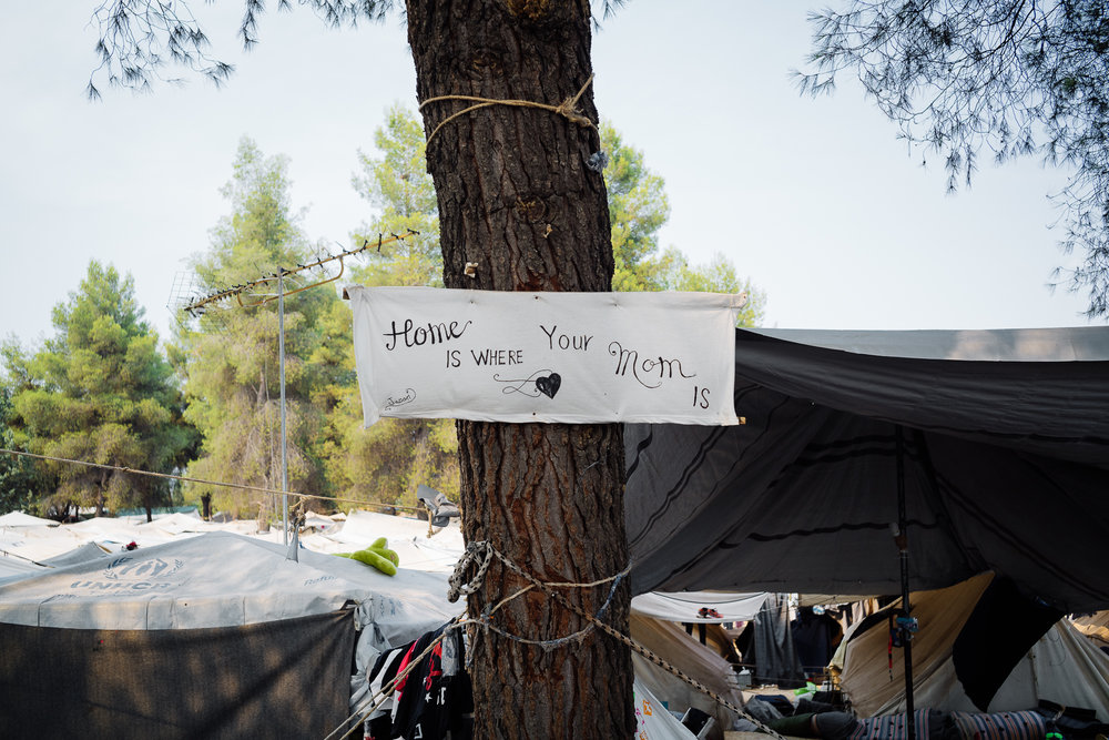 A sign put up by the Noh family outside of their tents.