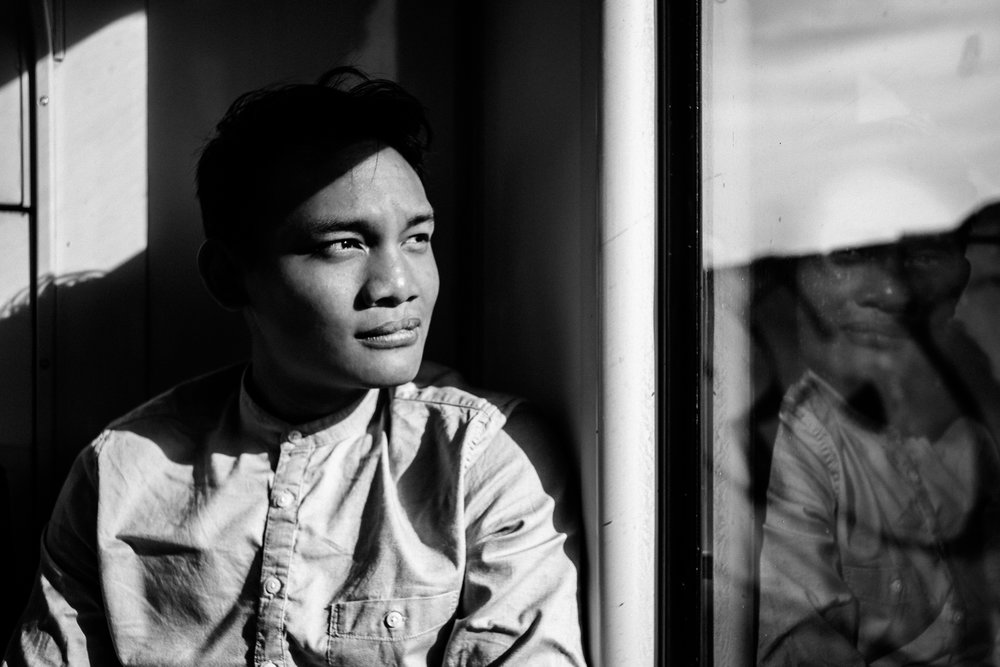 Arif Nurhakim  When it comes to the tool in his hands, Hakim sees himself first as a story teller then secondly as a photographer. The camera is his pen and the photograph is his empty canvas. Humbled by life experiences, he is a faithful lost believer in the play of world politics today.  Telling the untold and showing the unseen have ever since become his mantra in capturing photos. This will hopefully be able to shed some light on the present day human conditions that he continues to observe and document. Having developed an eye for street photography over six years and a keen interest in documentary/reportage, Hakim tries to blend in both styles together in his visual story telling.  When he is not scouting for stories, he roams the surface of the earth for new adventures.   CONTACT DETAILS:   For photography assignments, prints and further enquiries, you can reach him at: arifnurhakim.91@gmail.com