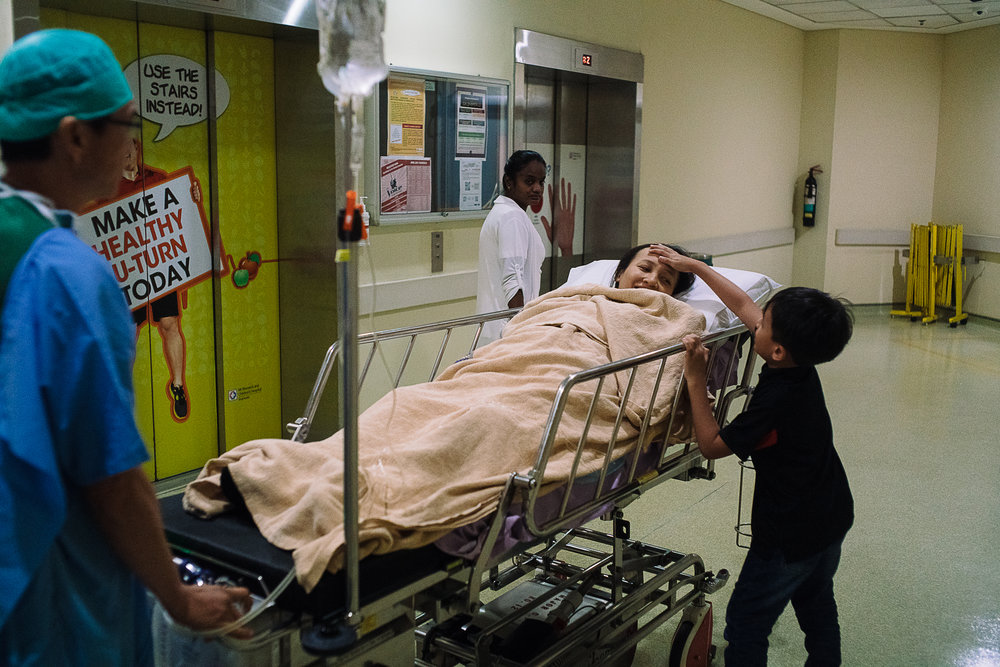 Two hours later, Hidayah finally came out from the operating theatre where her eldest son, Ryan, 8 years old, rushed to his  mama 's side to check up on her.  But there were still no news of the baby yet at this point.