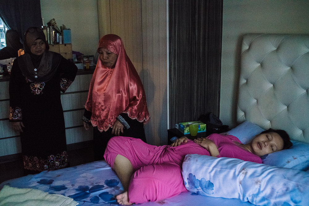 Both Hidayah's mother (M) and mother-in-law (L) visited Hidayah a day after she had been discharged from the hospital.