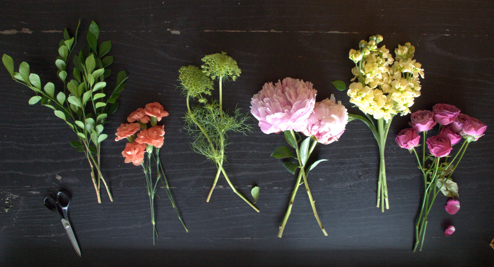 From left to right: coffee leaf, spray carnation, Queen Anne's Lace, pink peonies, double stock, garden spray roses.