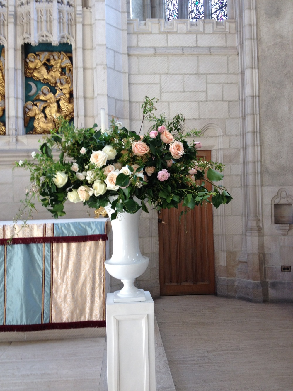 Here's a close-up of one of the large urn arrangements that flanked the altar. Designed by Lisa but executed by me!