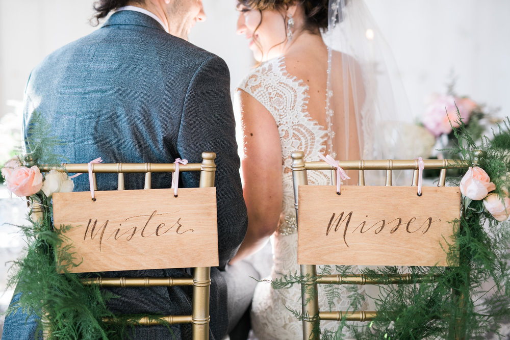 Mister and Misses chair signs with wood burned calligraphy | Quill+Oak Calligraphy and Lettering Toronto