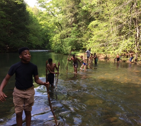 Students were all-in when given the chance to cross a creek on a spring adventure