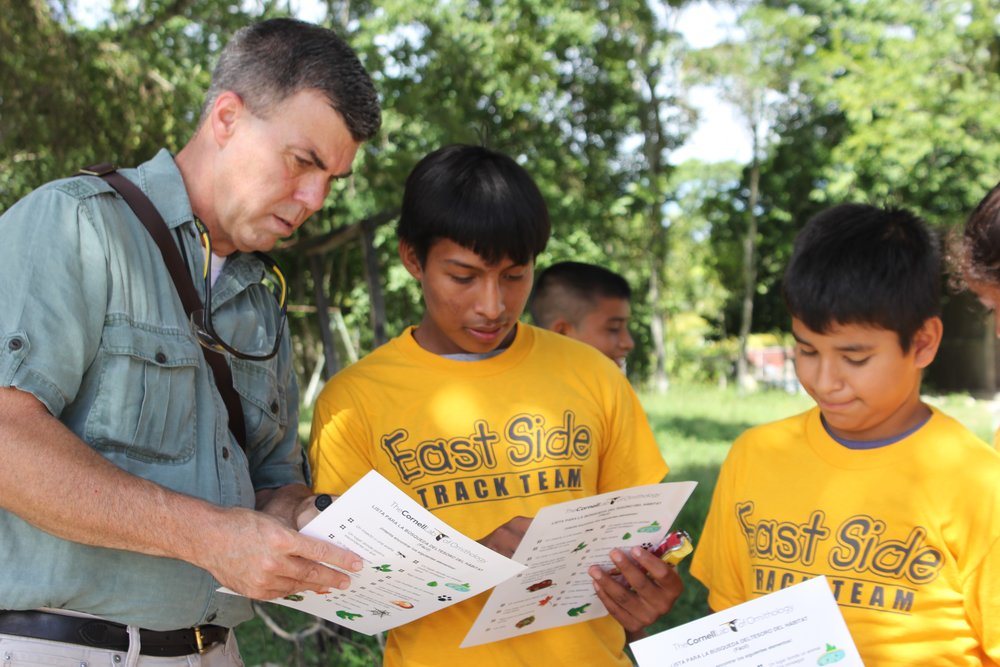 Flores Rick with Kids Cornell Work.jpg