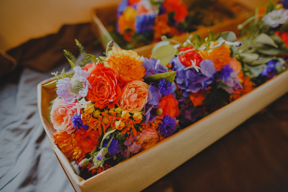 The couple chose a vibrant colour palette of oranges, corals and blues...