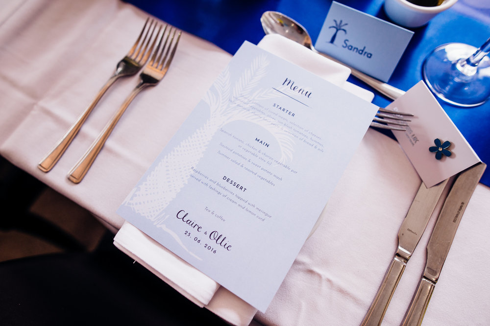 We wanted to keep the wedding menu clean and sophisticated for Claire and Ollie, yet still in line with the rest of the wedding stationery, and so we incorporated the palm tree painting but this time in a classy white silhouette  Abigail Steed Photography