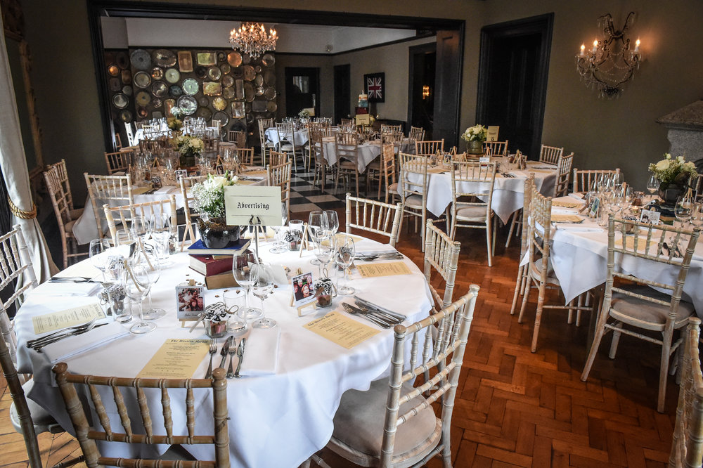 Each table was decorated with vintage newspaper style menus and table names, books and polaroid snaps of guests.  Photograph by   Paul Slater