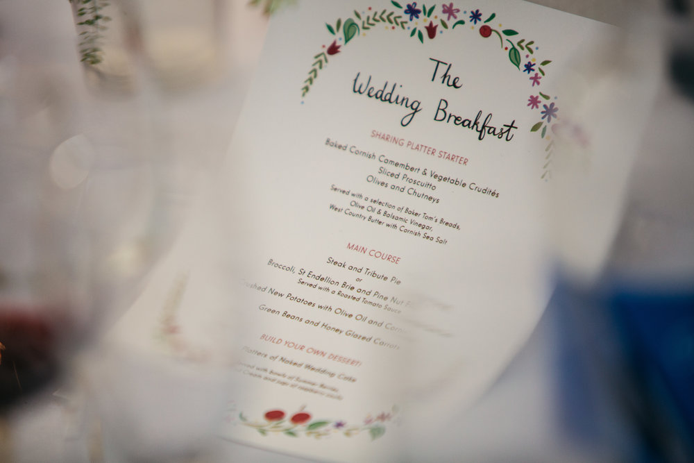 Signage like the table names and menus also featured the signature painted lettering and illustrated florals.