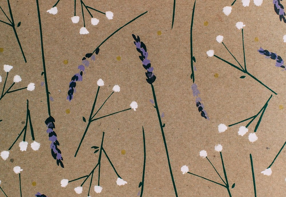 This custom Lavender and Gypsophila pattern created from hand painted florals features throughout their bespoke wedding stationery suite.