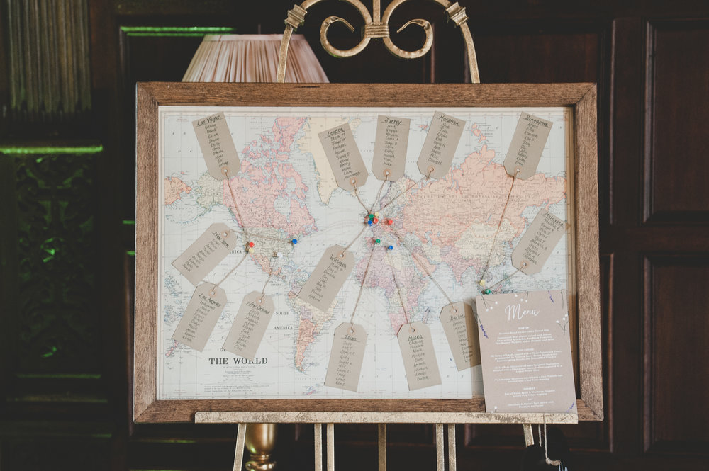 It's always lovely to see our designs mixed with couples' own DIY elements like this world map table plan and the wedding menu we designed for the couple.