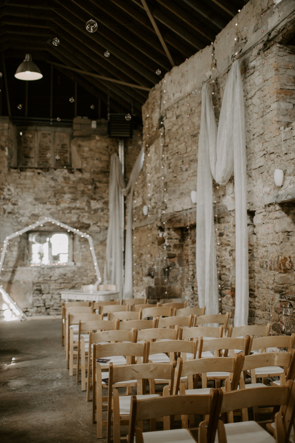 Groom Matt created the hexagon backdrop himself which added a contemporary twist to the chapel space at Ash Barton.