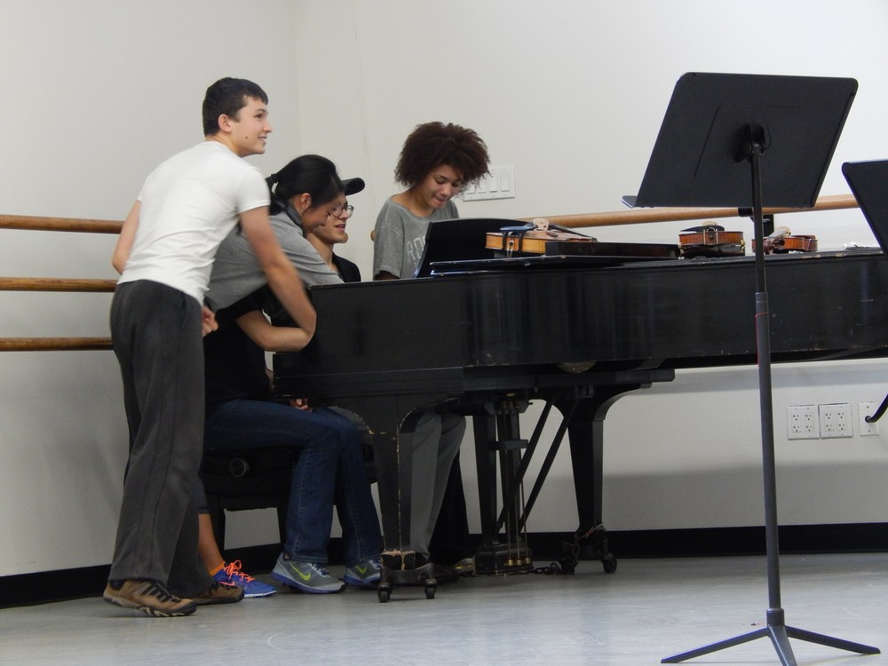 Students around a piano.jpg