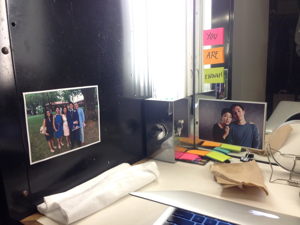 A personalized dressing room station with pictures from home.