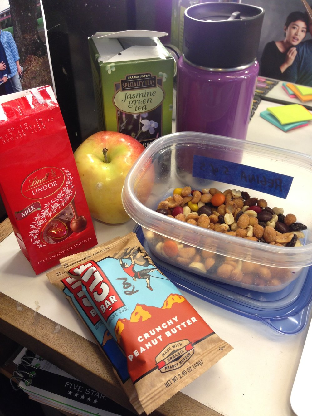 Must-have snacks to sustain me for the day include peanuts, Clif bars, fruits and tea.