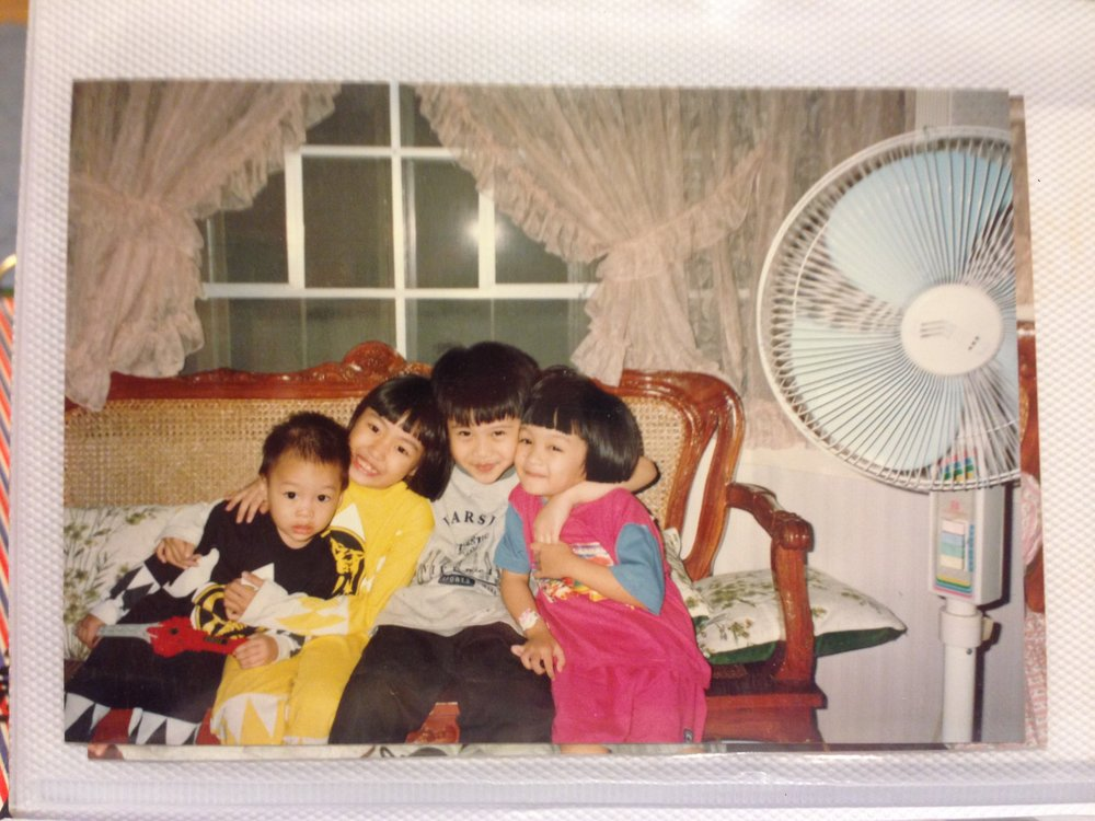 My siblings and my cousin in my grandparents' living room in Manila.