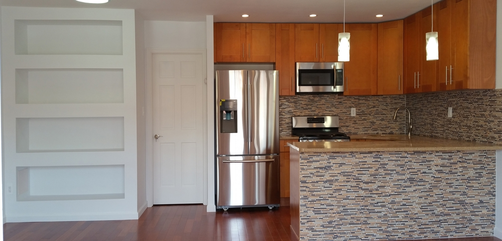 Free Stainless Steel Fridge    For every Kitchen Job   Until December 21   (347) 644-6611