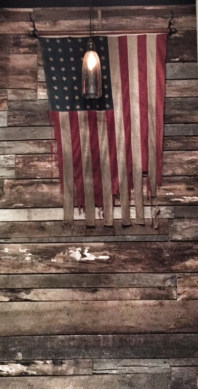 A really old American flag,just hanging in the hall like it's not a museum artifact. (At first we thought it might be the original, but Elizabeth astutely noted it has too many stars.