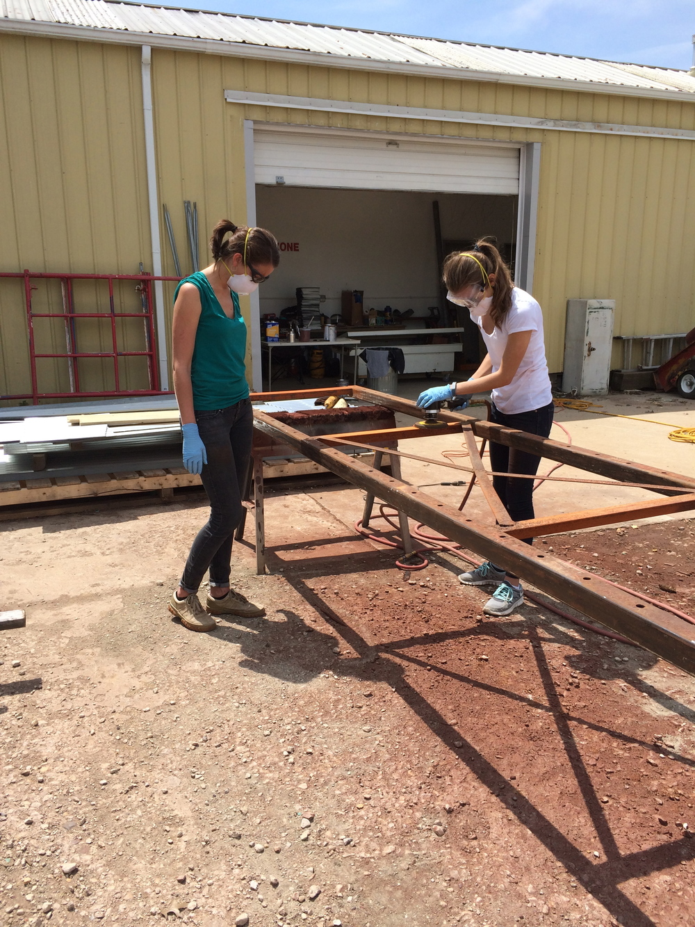 My sister Cerena and I sanding and prepping the structure for the Motorcycle Rack.