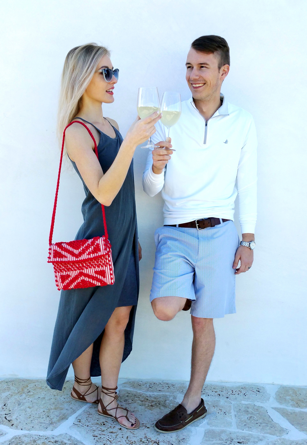 Marta is wearing gray high-low dress by Stateside, red hand bag by Antonello, sandals LeSwim & Krewe du Optic sunnies.   Adam is wearing Alys Beach logo popover & shorts -both by Peter Millar