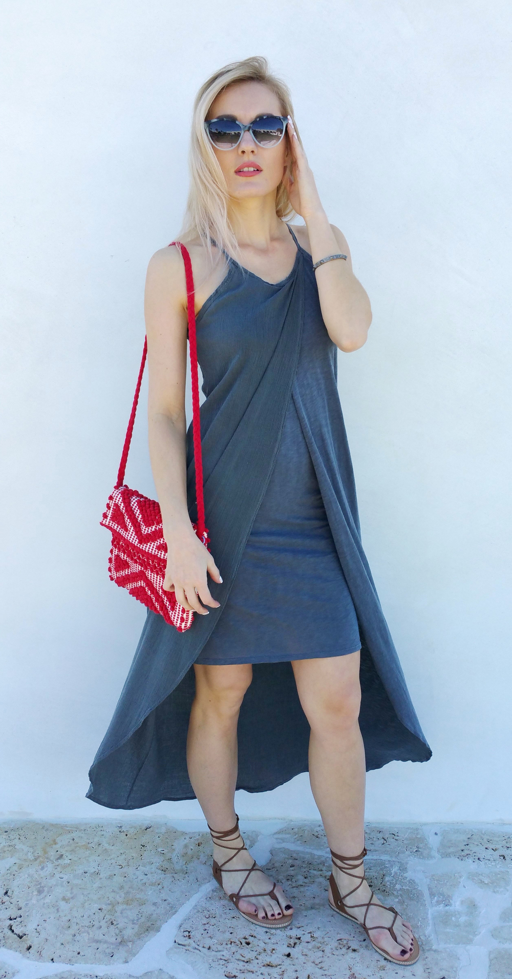 Marta is wearing gray high-low dress by Stateside, red hand bag by Antonello, sandals by LeSwim, Krewe du Optic sunnies & studded bracelet by S Carter.