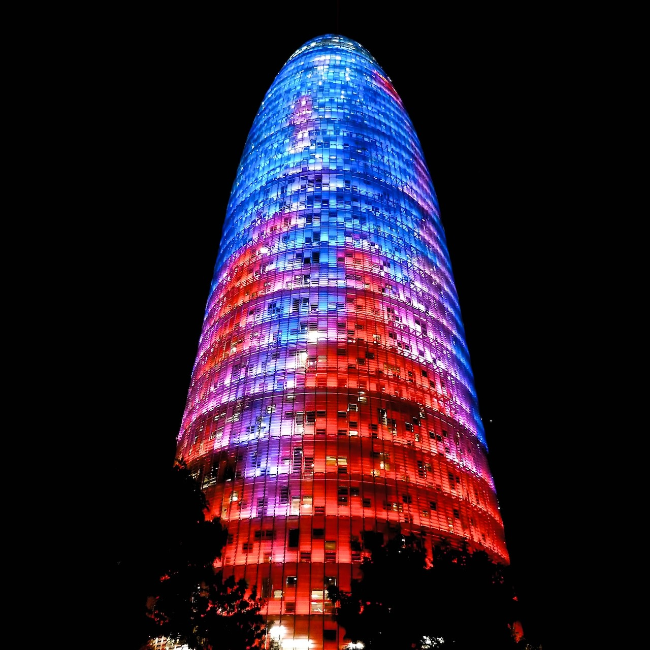The illuminated Torre Agbar at night; (cc) by-nc squics.com