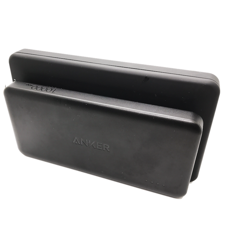 Anker PowerCore II Slim 10.000 mAh in front vs. AmazonBasics power bank in the back