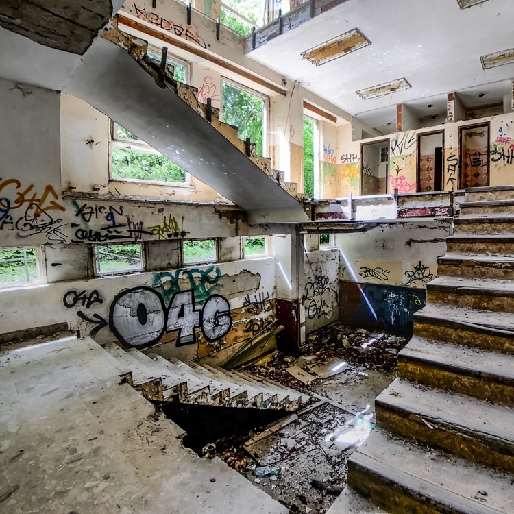 Use a fisheye lens to get this shot if the stairwell in the abandoned residential building